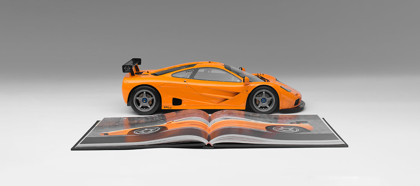 "McLaren F1 LM 1:8 scale model replica from Amalgam Collection alongside a copy of 'Driving Ambition"", signed by Gordon Murray"