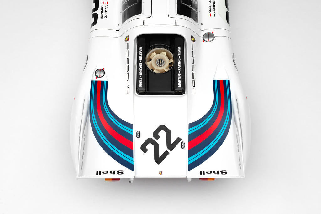For the ultimate collector, the 1:8 scale is currently available to order. This supremely detailed handcrafted recreation features opening doors and an openable engine cover, fully displaying the spartan race interior and superb 4.9 litre flat-12 atmospheric power unit.  The Team Martini Porsche finished two laps ahead of its rival John Wyer Porsche and an incredible 29 laps (386km) ahead of the third place Ferrari. The two Porsches were the first cars to cover over 5000km at Le Mans, clocking 5335km (3315 miles) at an average 222 km/h (138 mph). This was a phenomenal achievement in 1971, so much so that the record would stand for 39 years, cementing the 917K's dominance over this era of motorsport. That's pretty remarkable for a car that, when it was introduced two years prior, was deemed almost undriveable at high speed by even the finest of drivers.