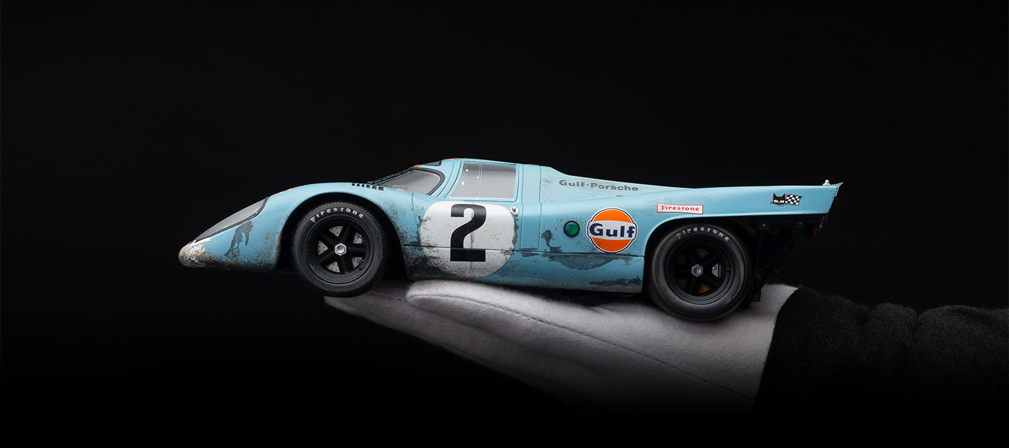 AmaLgam Collection Race Weathered Porsche 917K 1970 Daytona 24 Hours Winner in it's John Wyer Automotive Gulf Sponsored livery at 1:18 scale