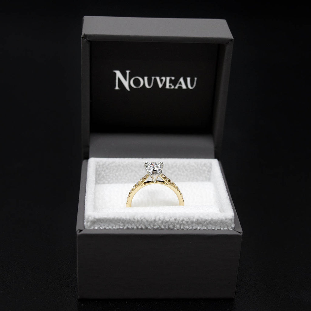 18ct Gold Pear Shaped Halo Diamond Engagement Ring in box, sold at Nouveau Jewellers in Manchester