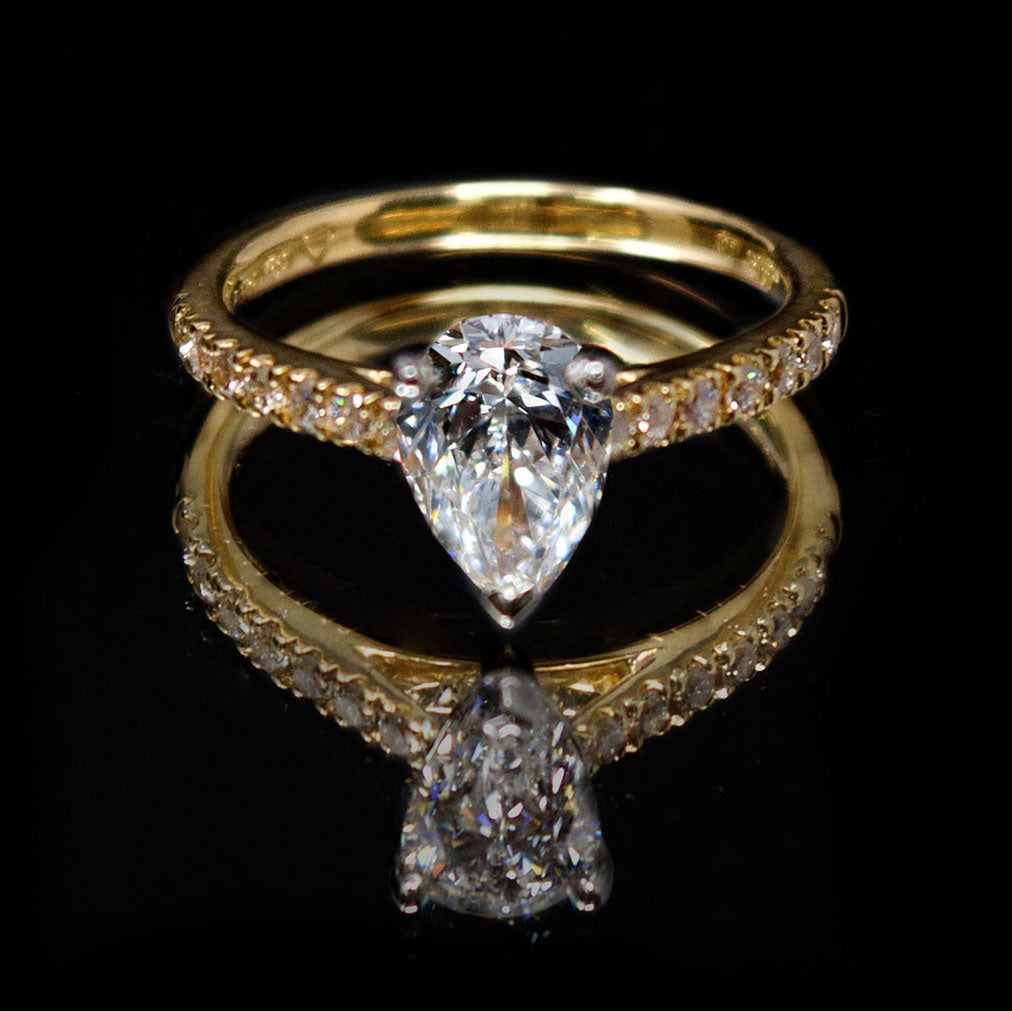 18ct Gold Pear Shaped Halo Diamond Engagement Ring, sold at Nouveau Jewellers in Manchester