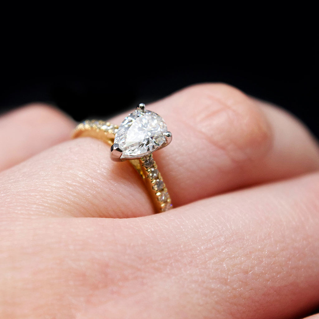 18ct Gold Pear Shaped Halo Diamond Engagement Ring on hand, sold at Nouveau Jewellers in Manchester