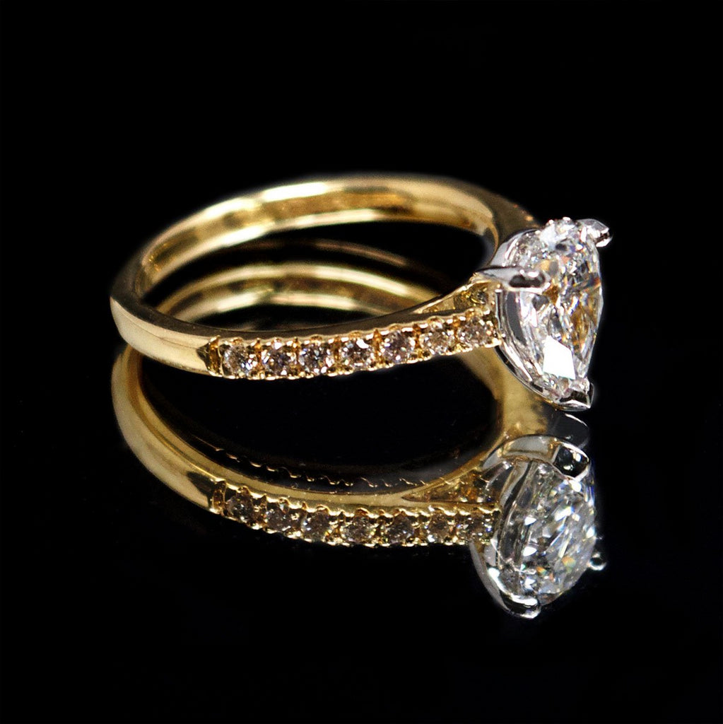 18ct Gold Pear Shaped Halo Diamond Engagement Ring side profile, sold at Nouveau Jewellers in Manchester
