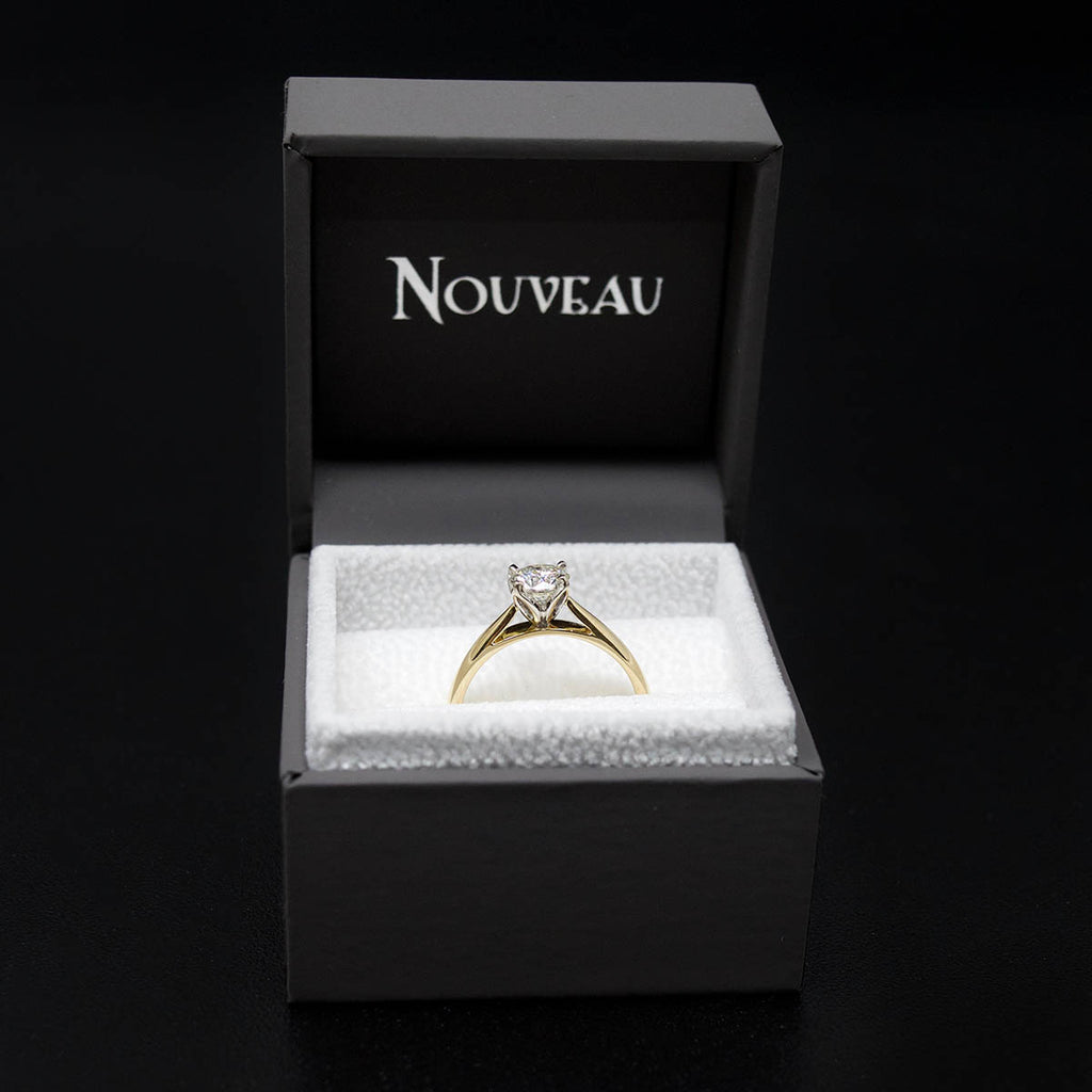 18ct Gold Petal Solitaire Diamond Engagement Ring in a box, sold at Nouveau Jewellers in Manchester