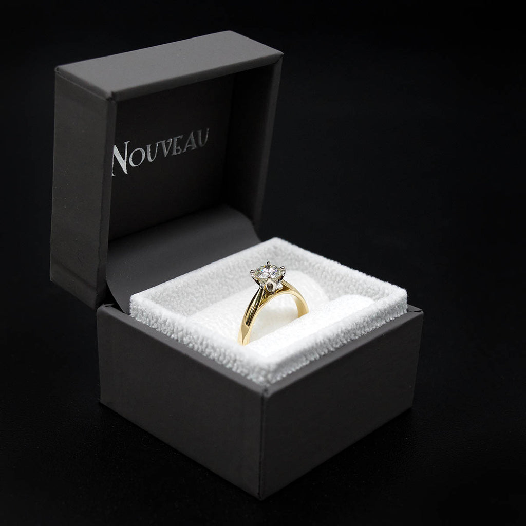 18ct Gold Petal Solitaire Diamond Engagement Ring in a box side profile, sold at Nouveau Jewellers in Manchester