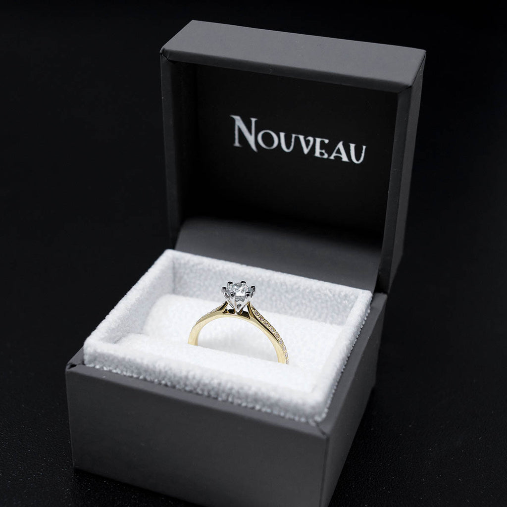18ct Yellow Gold Solitaire Diamond Engagement Ring with Diamond Shoulders in a box, sold at Nouveau Jewellers in Manchester
