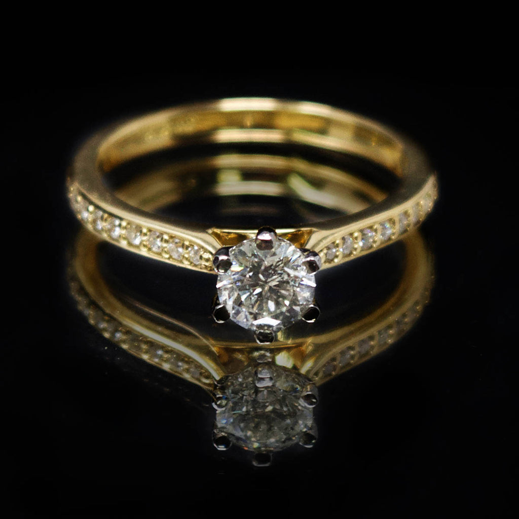 18ct Yellow Gold Solitaire Diamond Engagement Ring with Diamond Shoulders, sold at Nouveau Jewellers in Manchester