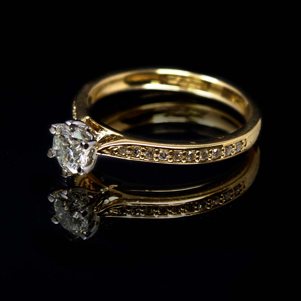 18ct Yellow Gold Solitaire Diamond Engagement Ring with Diamond Shoulders side profile, sold at Nouveau Jewellers in Manchester
