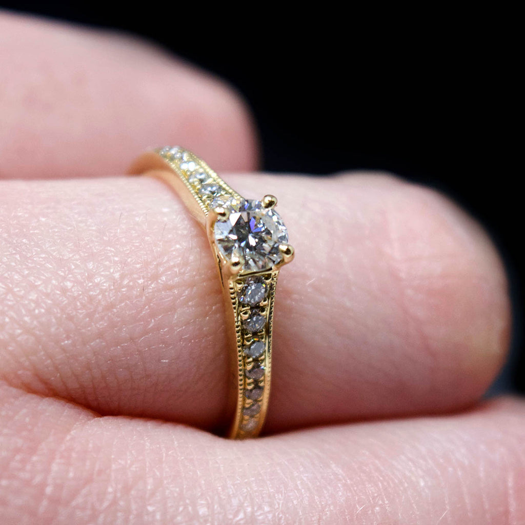 18ct Yellow Gold Vintage Solitaire Diamond Cluster Engagement Ring side profile on finger, sold at Nouveau Jewellers in Manchester