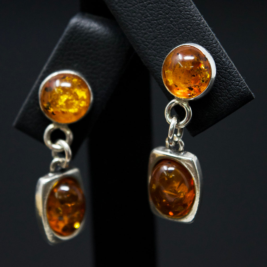 Silver Amber Pendant Earrings close up, sold at Nouveau Jewellers in Manchester