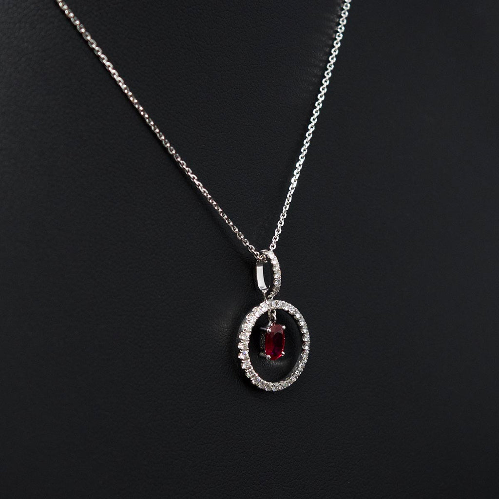 Nouveau Jewellers, Ruby and diamond halo necklace, brilliant cut diamonds, oval cut ruby, Manchester Jewellers