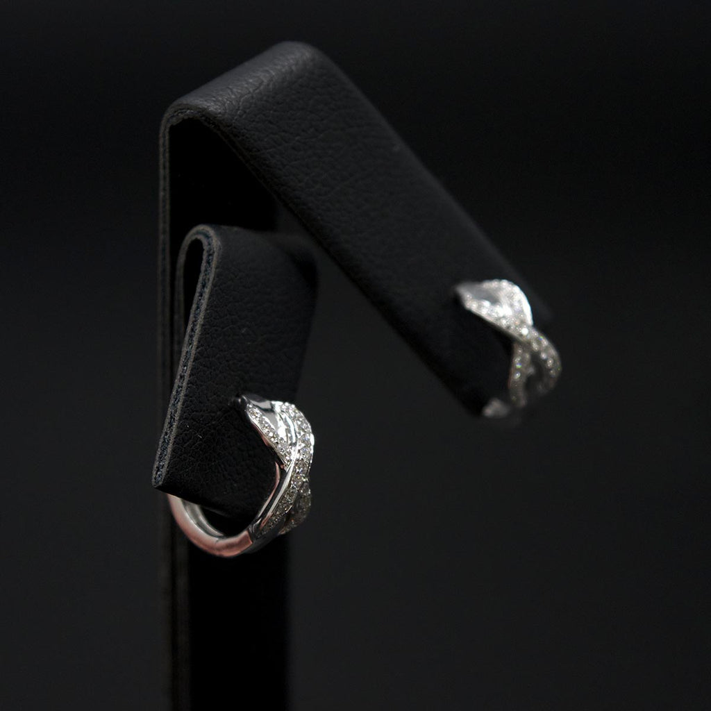18ct White Gold Infinity Diamond Hoop Earrings different angle, sold at Nouveau Jewellers in Manchester