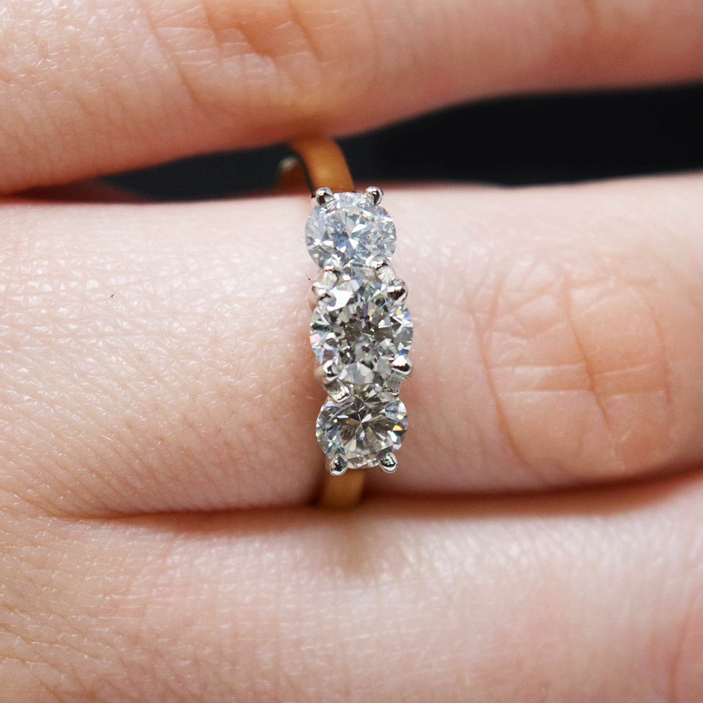18ct Yellow Gold Trilogy Diamond Engagement Ring on finger, sold at Nouveau Jewellers in Manchester