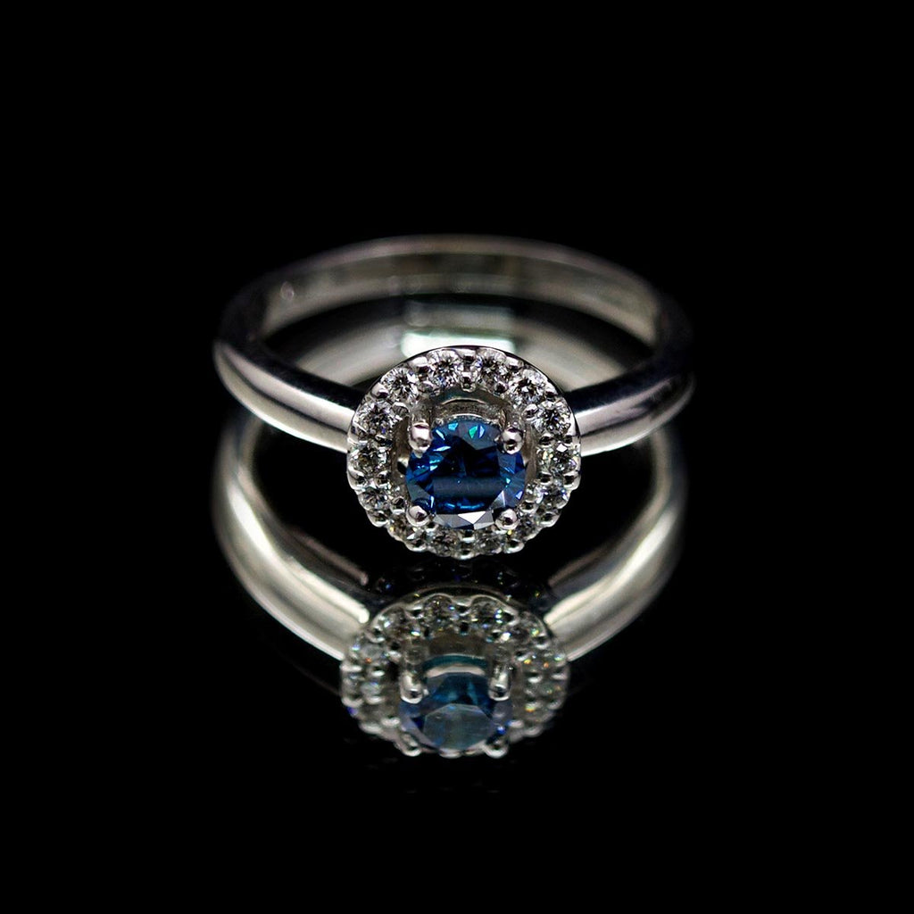 18ct White Gold Blue Diamond Halo Engagement Ring, sold at Nouveau Jewellers in Manchester
