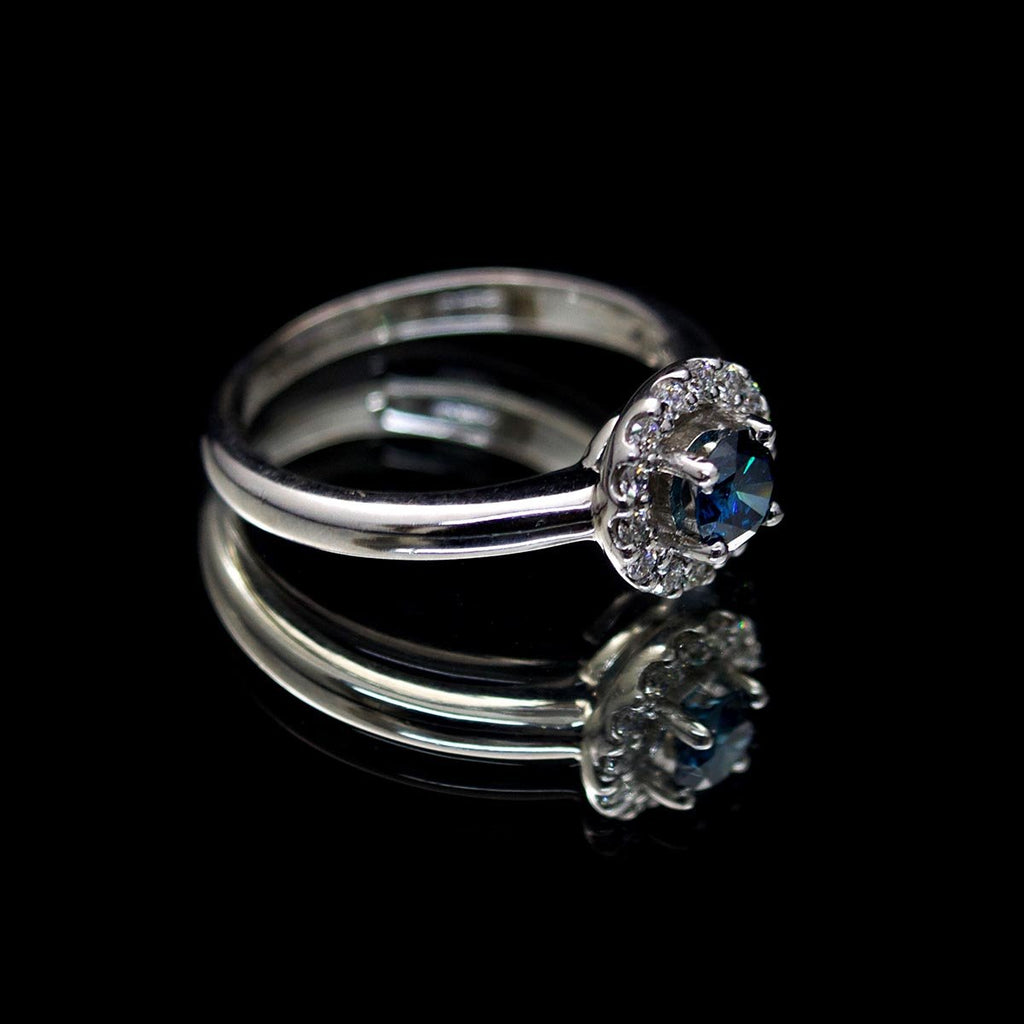 18ct White Gold Blue Diamond Halo Engagement Ring side profile, sold at Nouveau Jewellers in Manchester