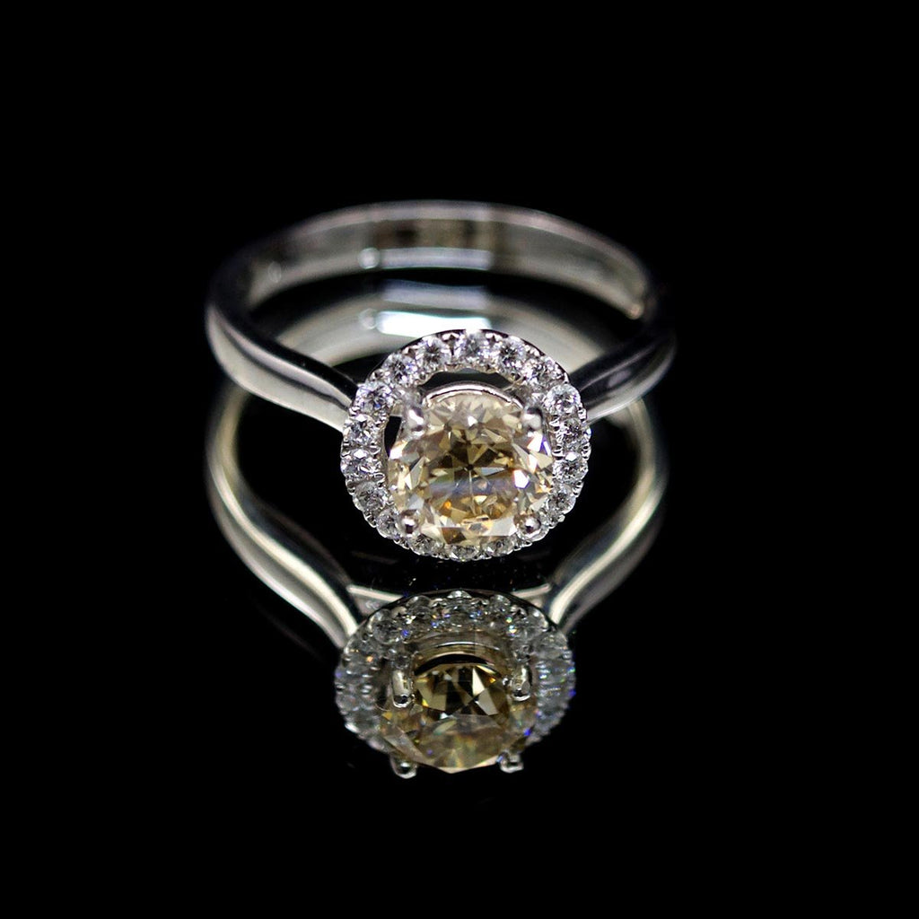 Platinum Halo Yellow Diamond Engagement Ring, sold at Nouveau Jewellers in Manchester
