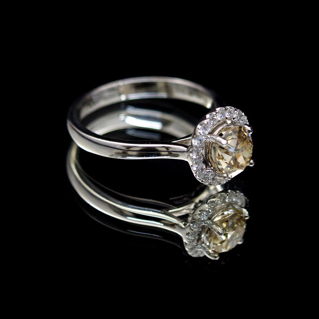 Platinum Halo Yellow Diamond Engagement Ring side profile, sold at Nouveau Jewellers in Manchester