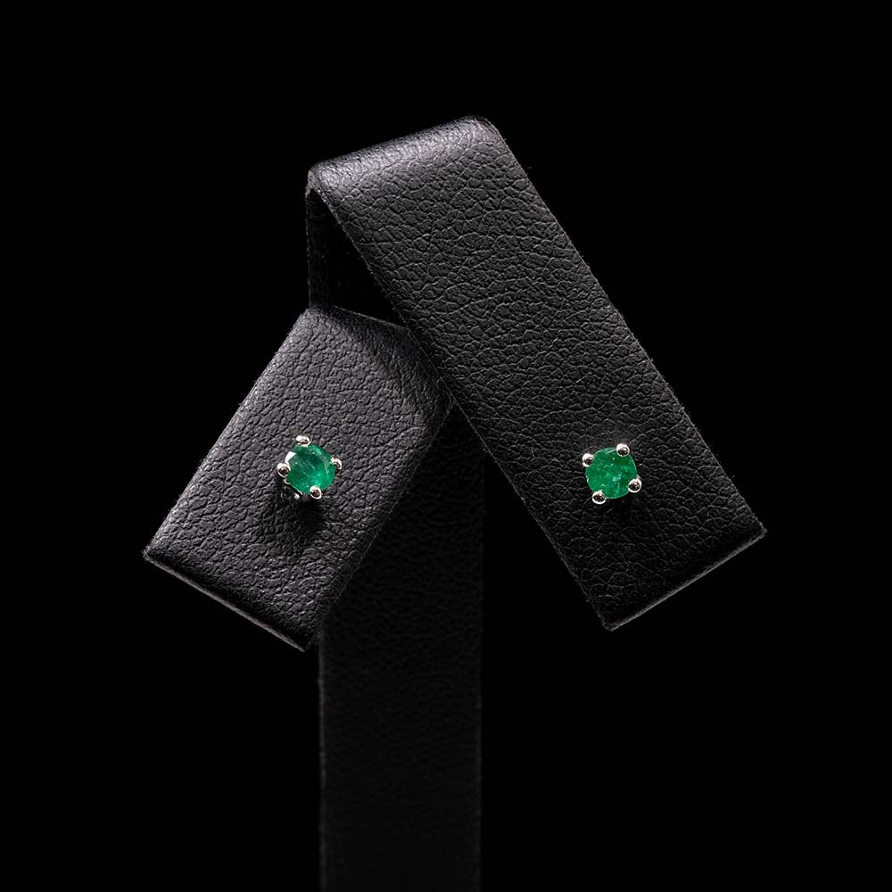 White Gold Minimal Emerald Stud Earrings Close Up, sold at Nouveau Jewellers in Manchester