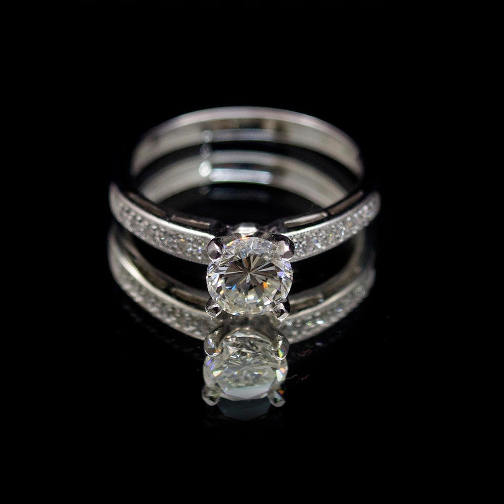 18ct White Gold Solitaire Diamond Engagement Ring with Pavé Shoulders, sold at Nouveau Jewellers in Manchester