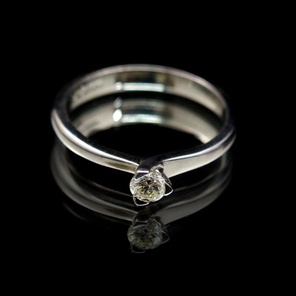 Platinum Twisted Design Solitaire Diamond Engagement Ring, sold at Nouveau Jewellers in Manchester