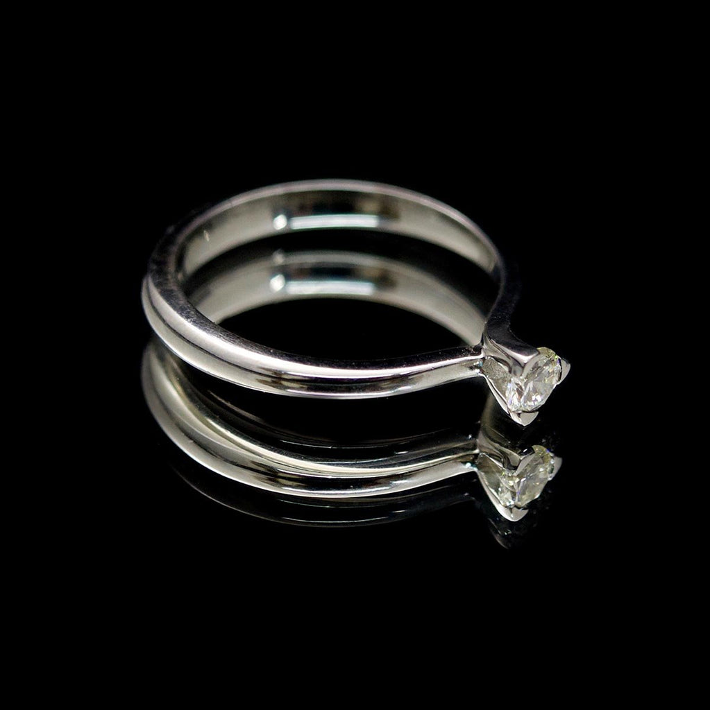 Platinum Twisted Design Solitaire Diamond Engagement Ring side profile, sold at Nouveau Jewellers in Manchester