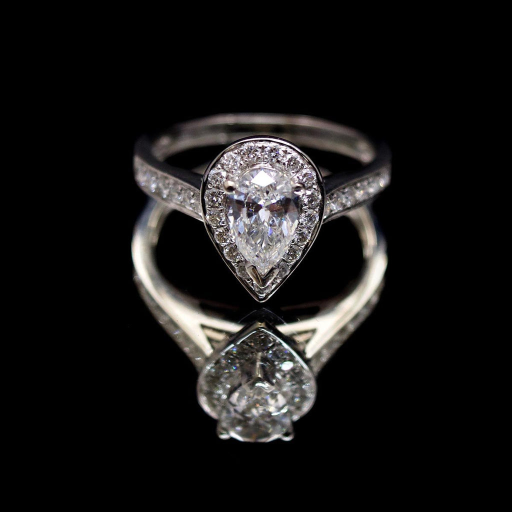 18ct White Gold Pear Shaped Halo Diamond Engagement Ring, sold at Nouveau Jewellers in Manchester
