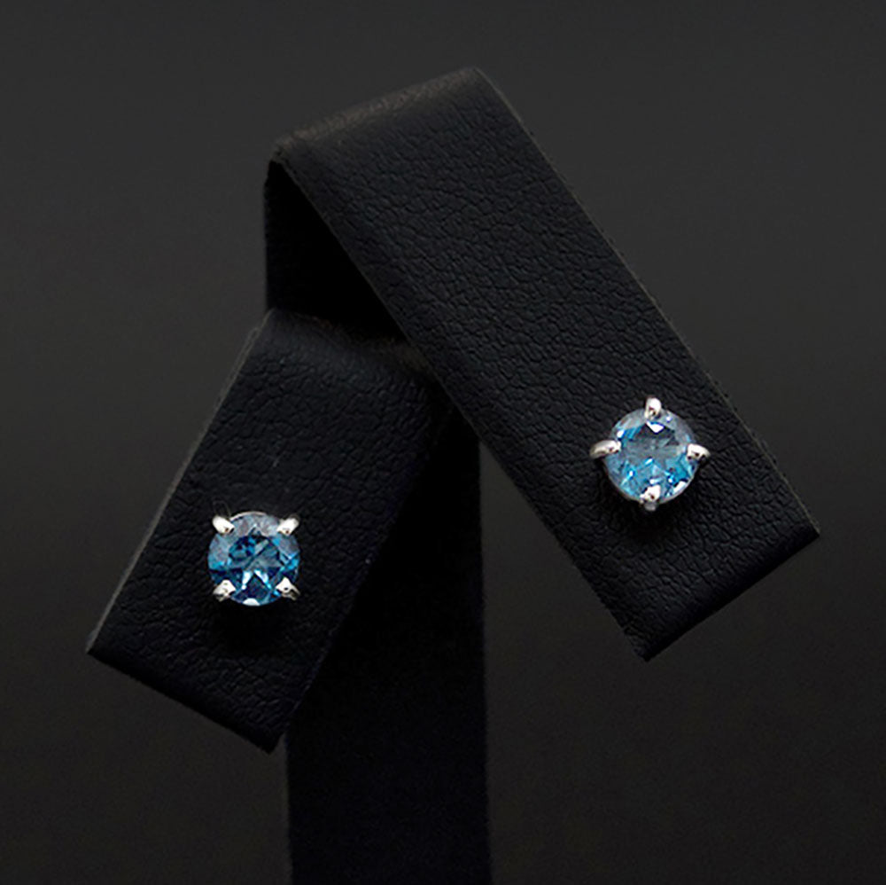 18ct White Gold London Blue Topaz studs close up, sold at Nouveau Jewellers in Manchester