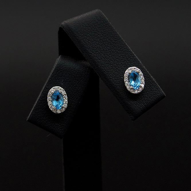 18ct White Gold London Blue Topaz and Diamond studs close up, sold at Nouveau Jewellers in Manchester