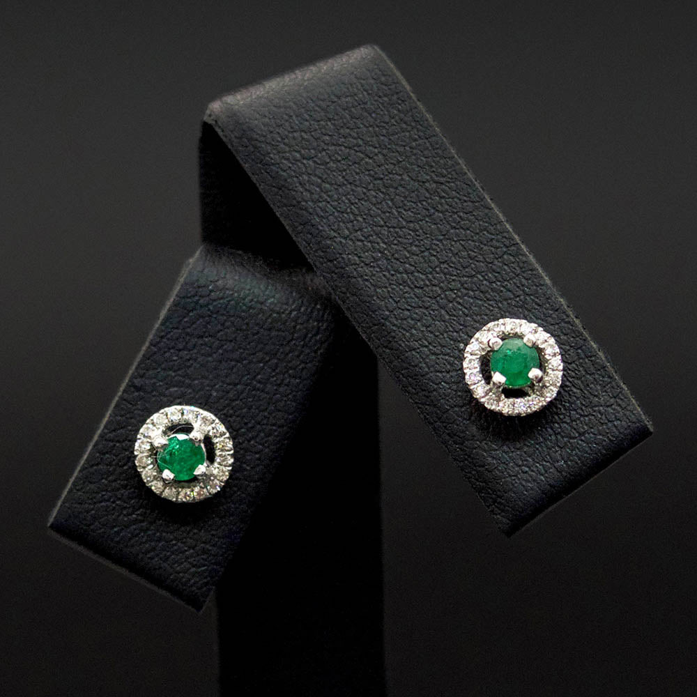 18ct White Gold Emerald and Diamond Halo Stud Earrings close up, sold at Nouveau Jewellers in Manchester