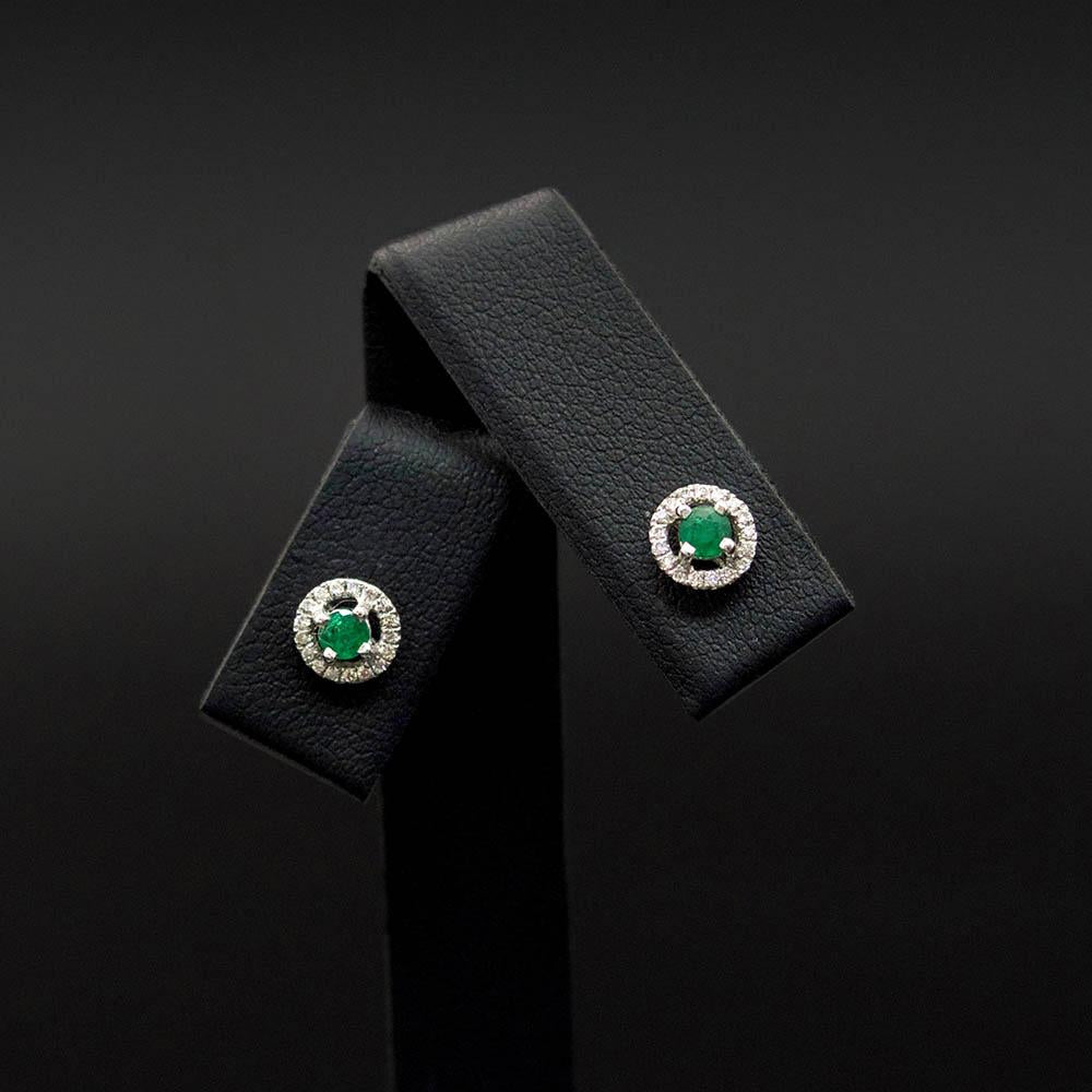 18ct White Gold Emerald and Diamond Halo Stud Earrings, sold at Nouveau Jewellers in Manchester