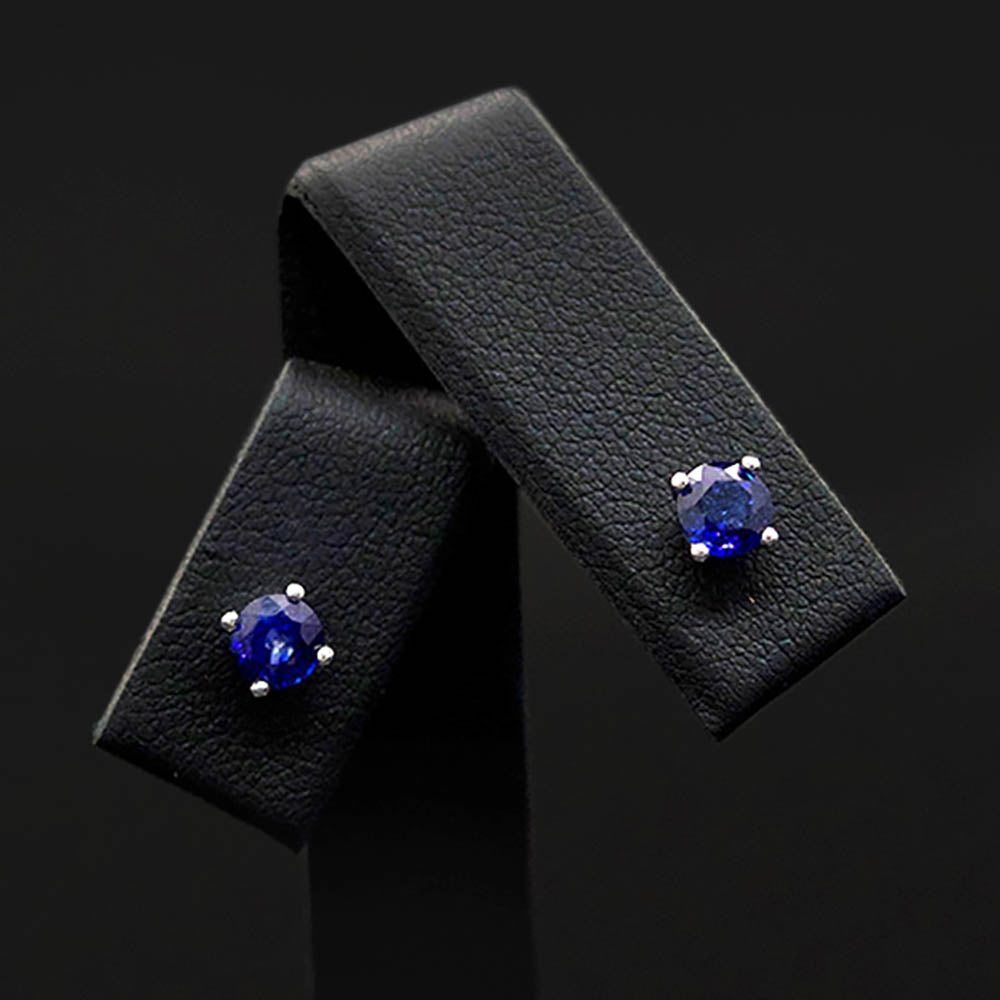 18ct White Gold Royal Blue Sapphire Stud Earrings close up, sold at Nouveau Jewellers in Manchester