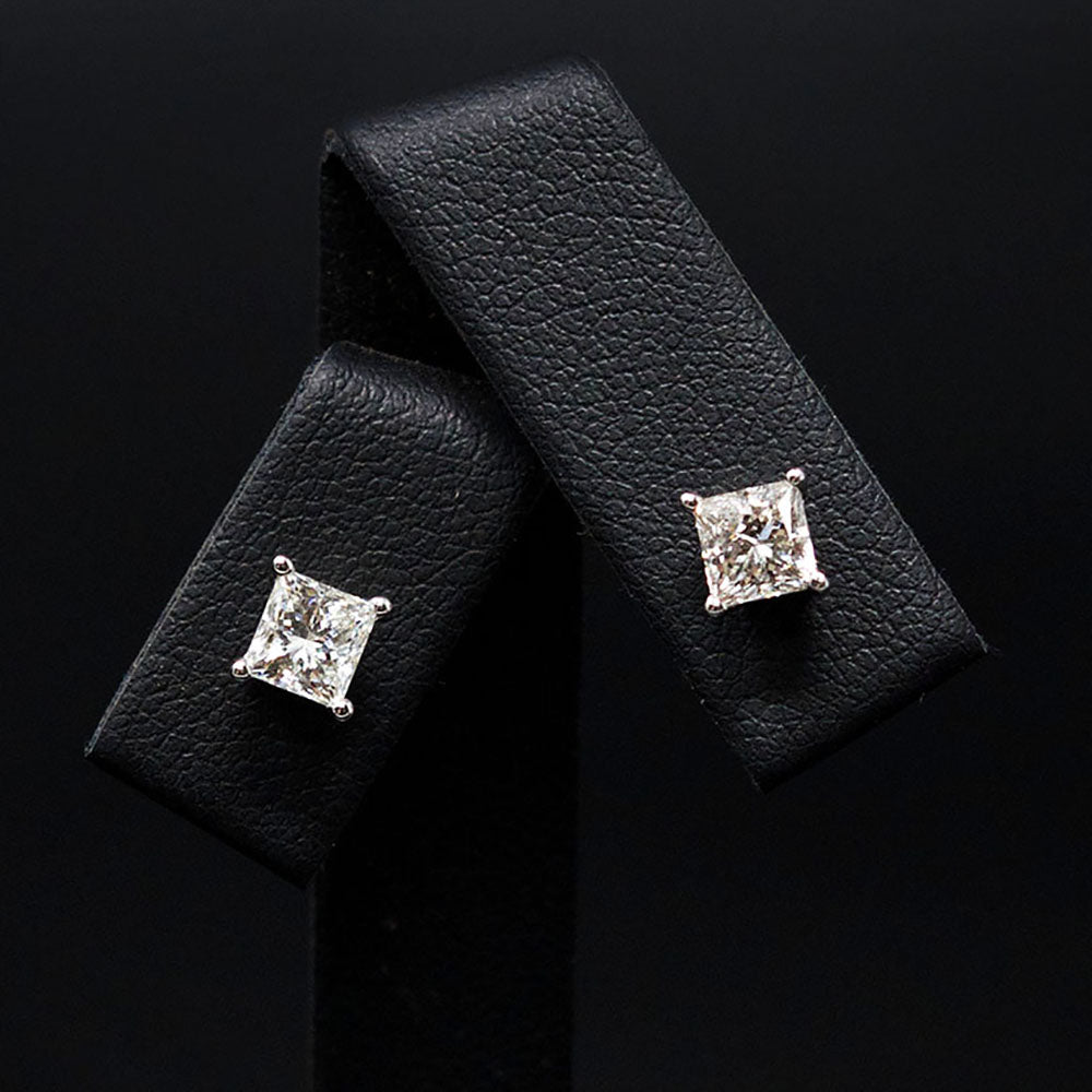 18ct White Gold Signature Princess Cut Diamond Stud Earrings close up, sold at Nouveau Jewellers in Manchester