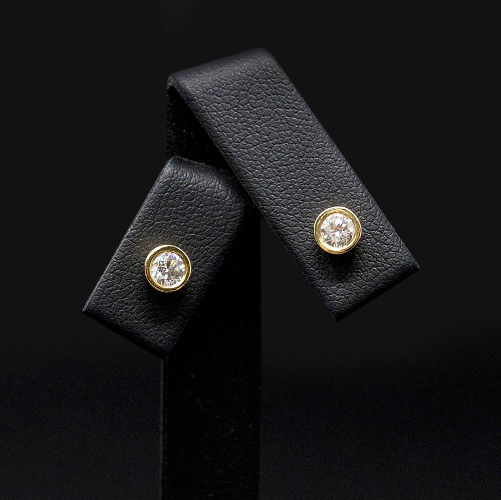 18ct Yellow Gold Sleek Diamond Stud Earrings close up, sold at Nouveau Jewellers in Manchester