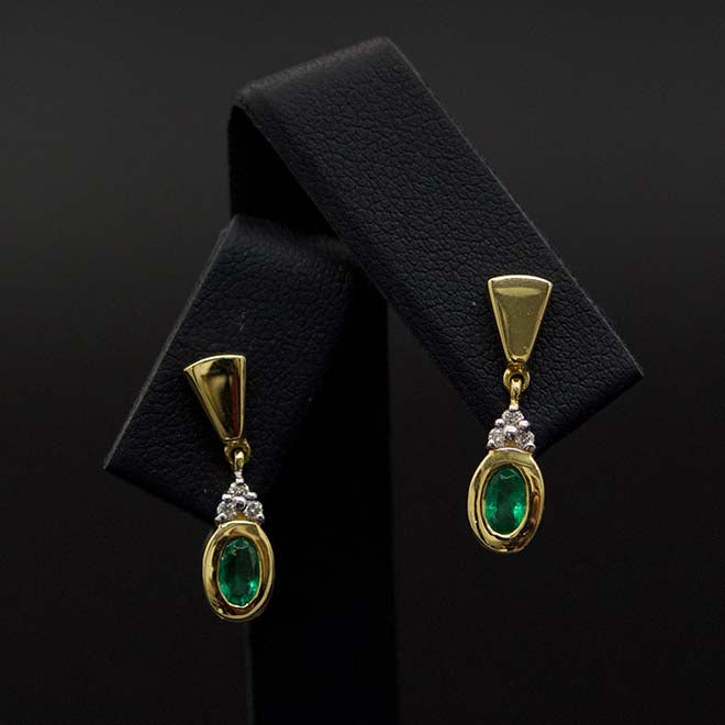 Gold, Emerald and Diamond Pendant Earrings Close Up, sold at Nouveau Jewellers in Manchester