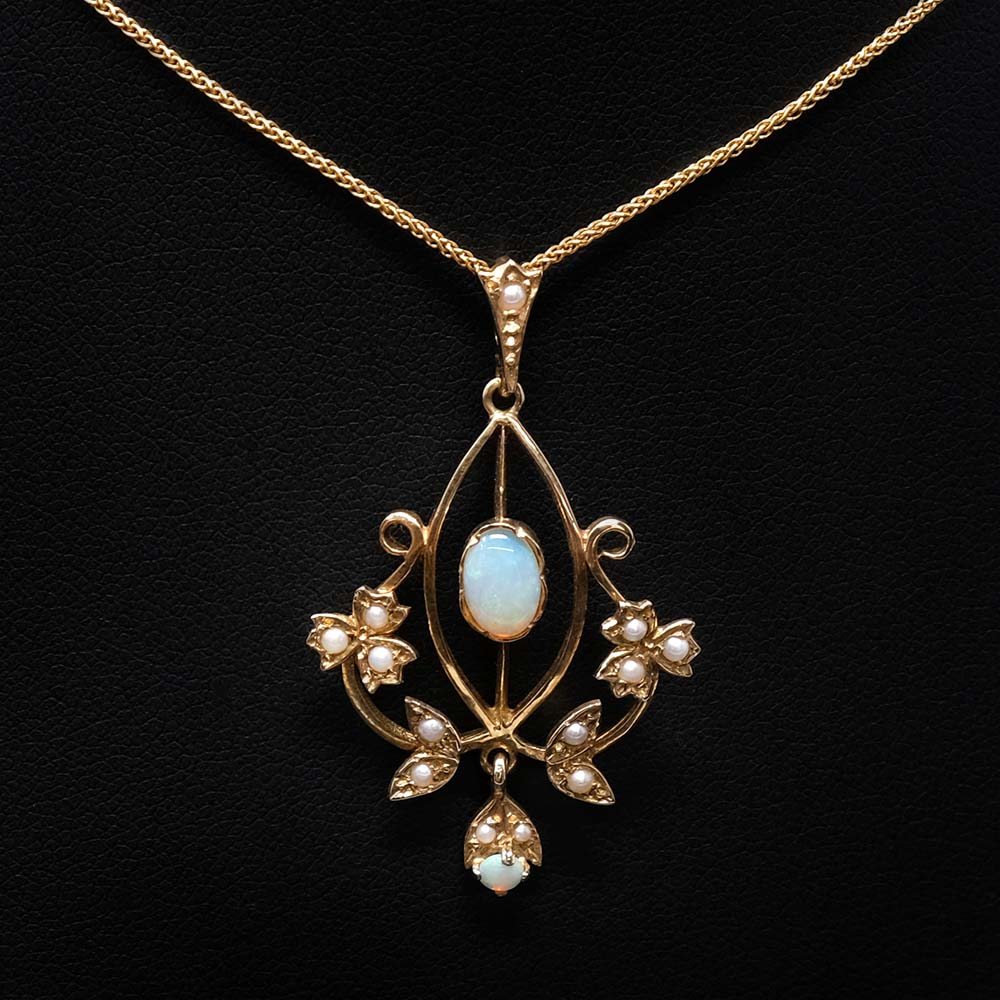 Vintage Yellow Gold Opal with Seed Pearls pendant necklace close up, sold at Nouveau Jewellers Manchester