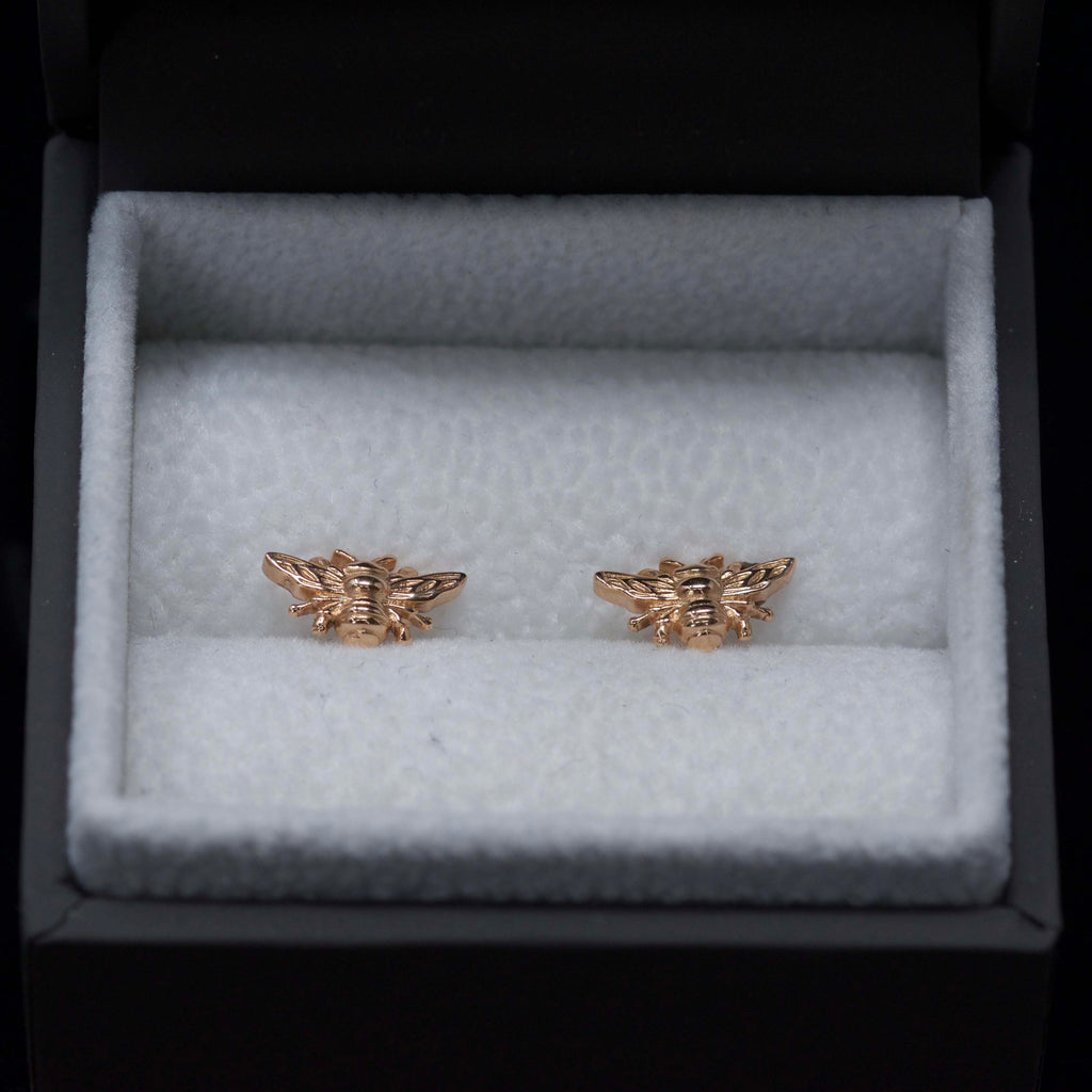 Rose Gold Manchester Bee Studs close up in box, Beehive Collection exclusively sold at Nouveau Jewellers in Manchester