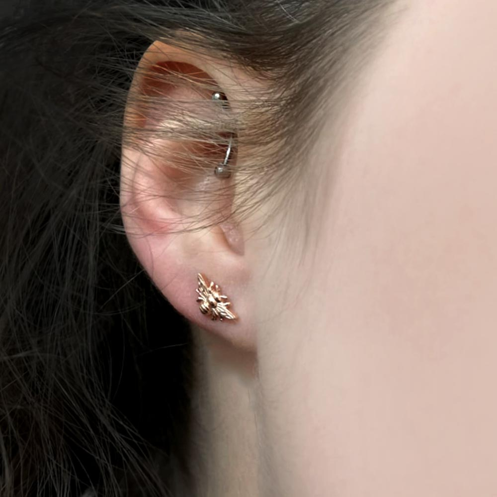 Rose Gold Manchester Bee Studs in girls ear, Beehive Collection exclusively sold at Nouveau Jewellers in Manchester