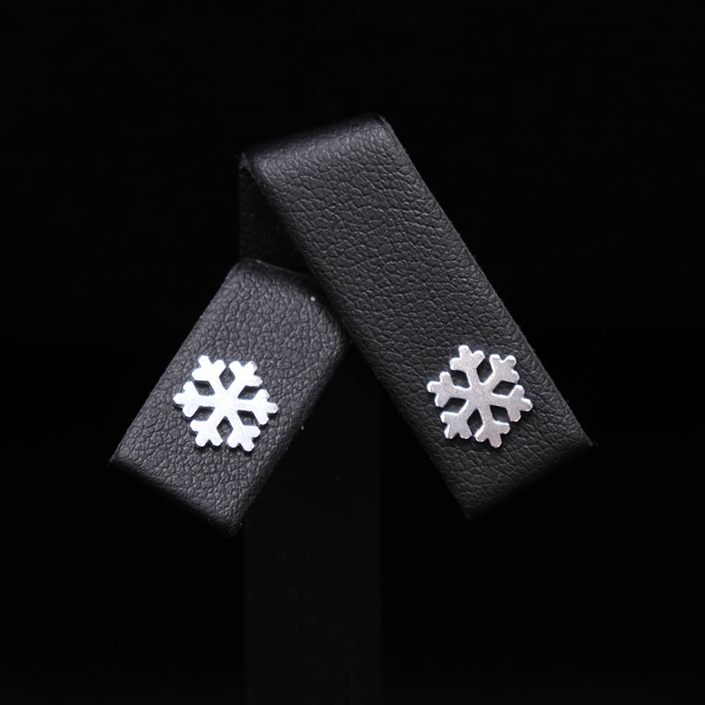 925 Silver Snowflake Stud Earrings close up, sold at Nouveau Jewellers in Manchester