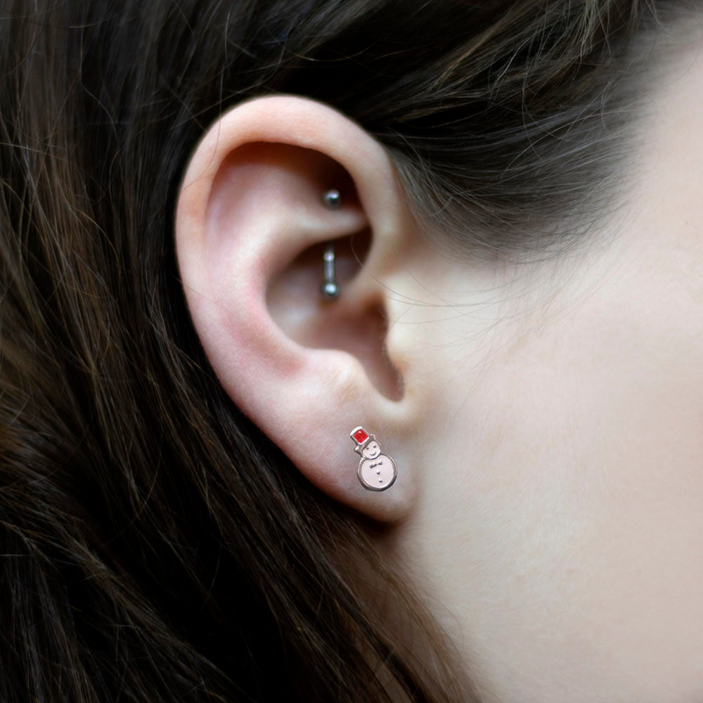 925 Silver Snowman Stud Earrings in girls ear, sold at Nouveau Jewellers in Manchester