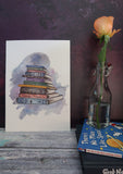Watercolour stack of old textbooks all about space on display as space themed decor- art prints by Ink and Tot