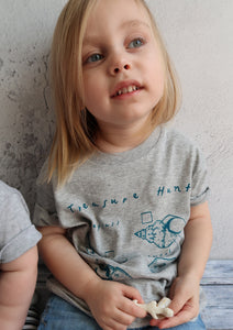 toddler girl wearing grey organic tshirt with beach print