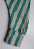 close up of a cuff on turquoise stripy childrens trousers