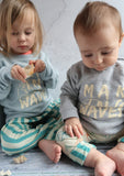 toddler and baby wearing matching grey beach jumpers