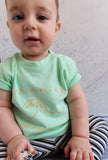 baby wearing mint green screenprinted tshirt