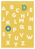 retro yellow alphabet print with floral patterned letters