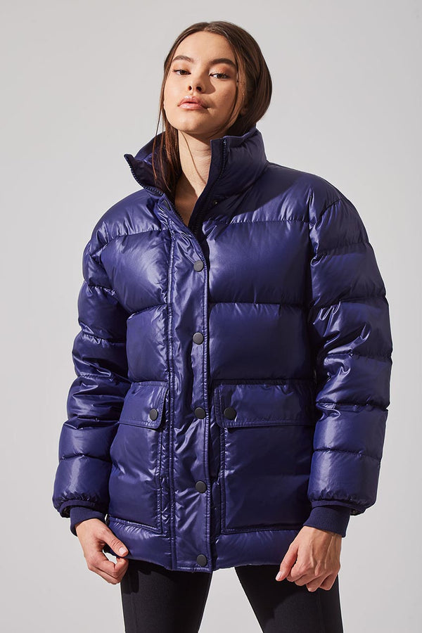 MPG Sport women's Traveler Down Filled Recycled Polyester Cargo Parka in Indigo