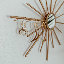 gold bullhorn earrings
