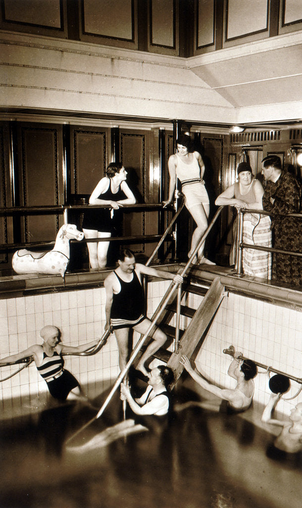Passengers on aboard an unidentified cruise liner relax around the swimming pool in the very latest fashions by unknown