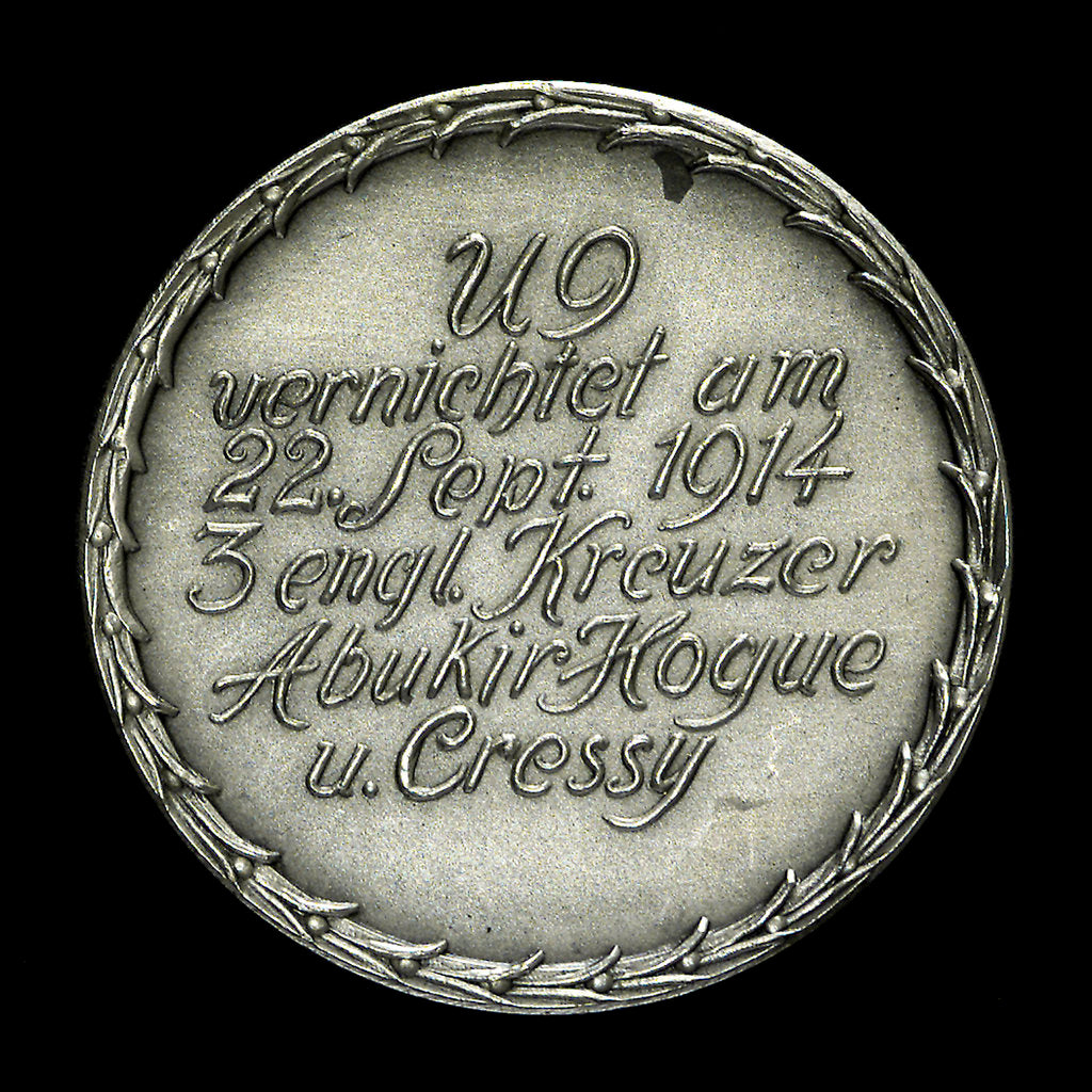 Detail of Medal commemorating the destruction of the English armoured cruisers 'Aboukir', 'Hogue' and 'Cressy' by 'U9', 1914; obverse by F. H.
