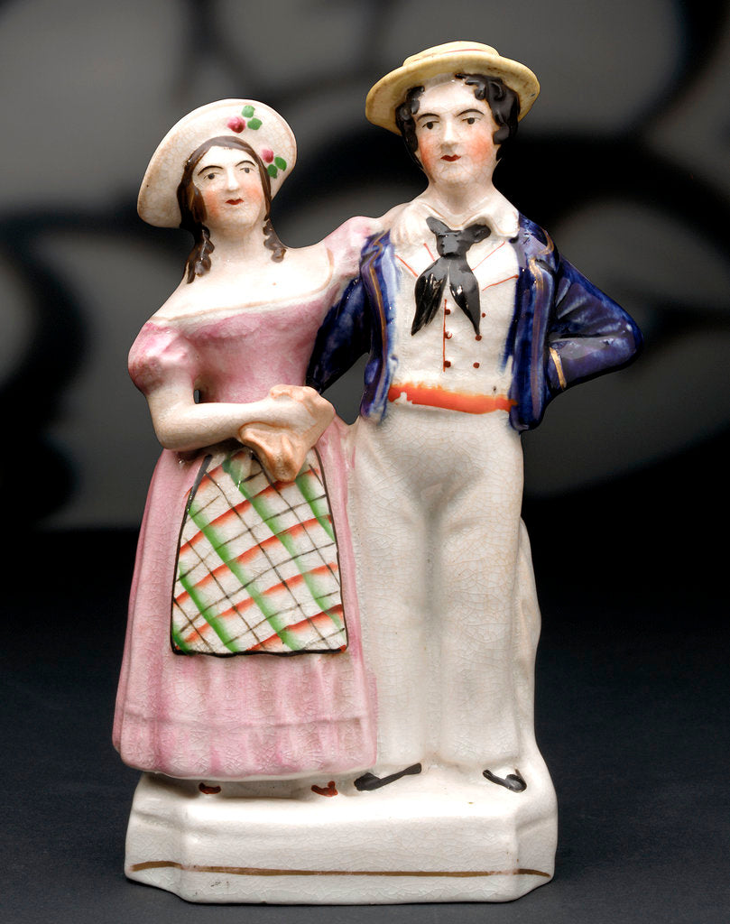 Earthenware figure group depicting a sailor and lass by unknown